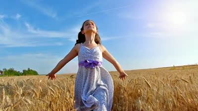 stock-footage-little-girl-running-cross-the-wheat-field-at-sunset-slow-motion-high-speed-camera