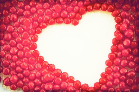 heart-shape-outlined-by-red-cinnamon-candy-kim-fearheiley-photography