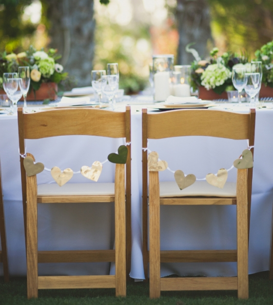 hearts on back of wedding chairs